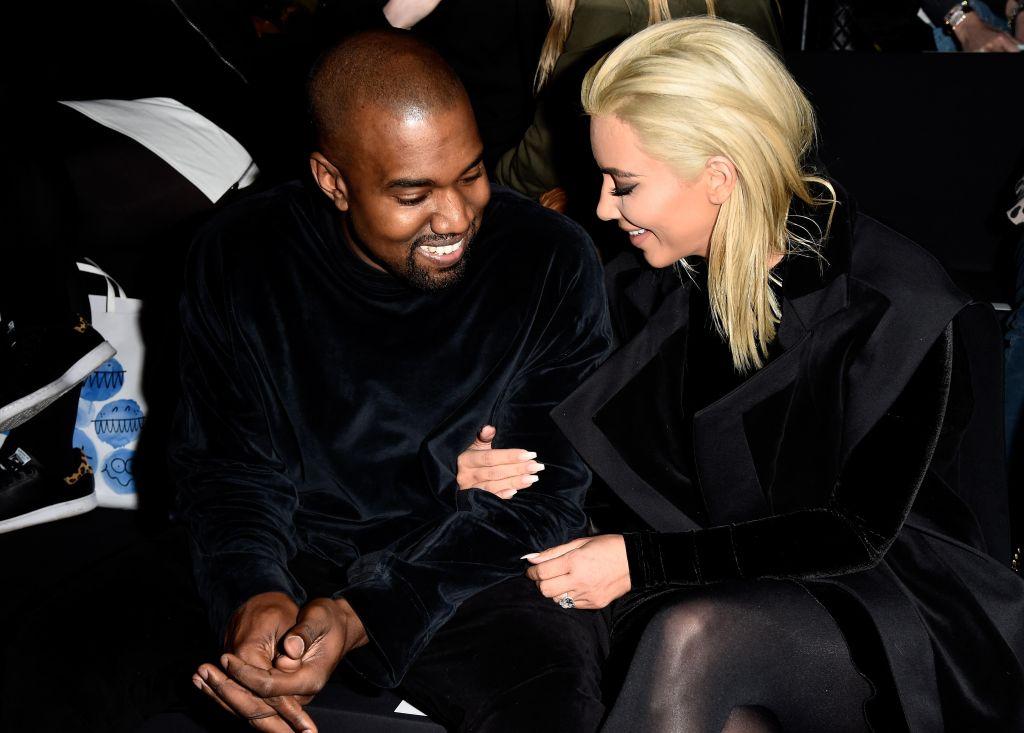Kim Kardashian and Kanye West attend Balmain show during Paris Fashion Week