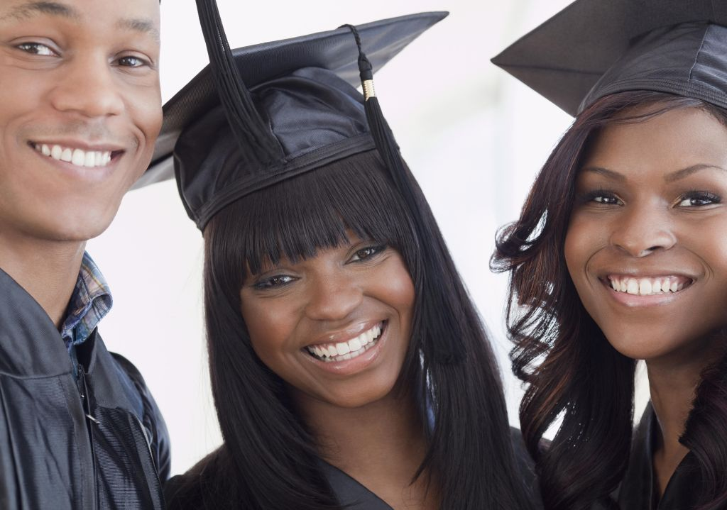 African friends in graduation cap and gown