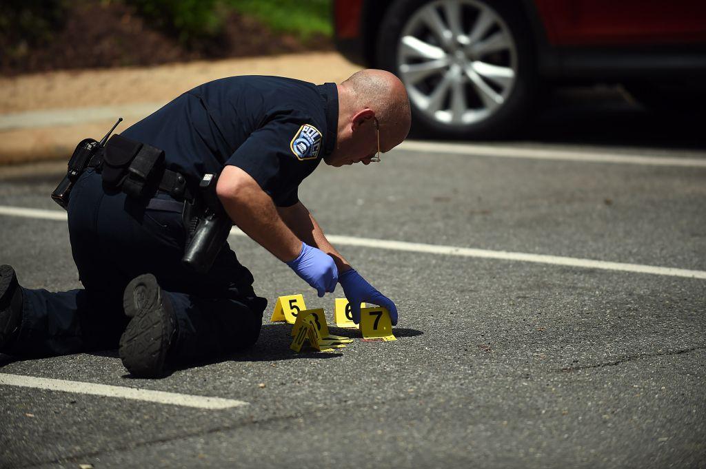 ARLINGTON, VA - May 18: Crime scene marker are placed near an a