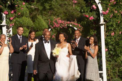 Wedding guests applauding newlyweds
