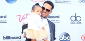 Daddy's Girl: Chris Brown Shares Adorable Photos Of Royalty Dripping In Fur