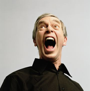 Mature man yelling, close-up, low angle view