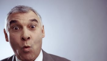 Close up of businessman pursing lips with eyebrows raised