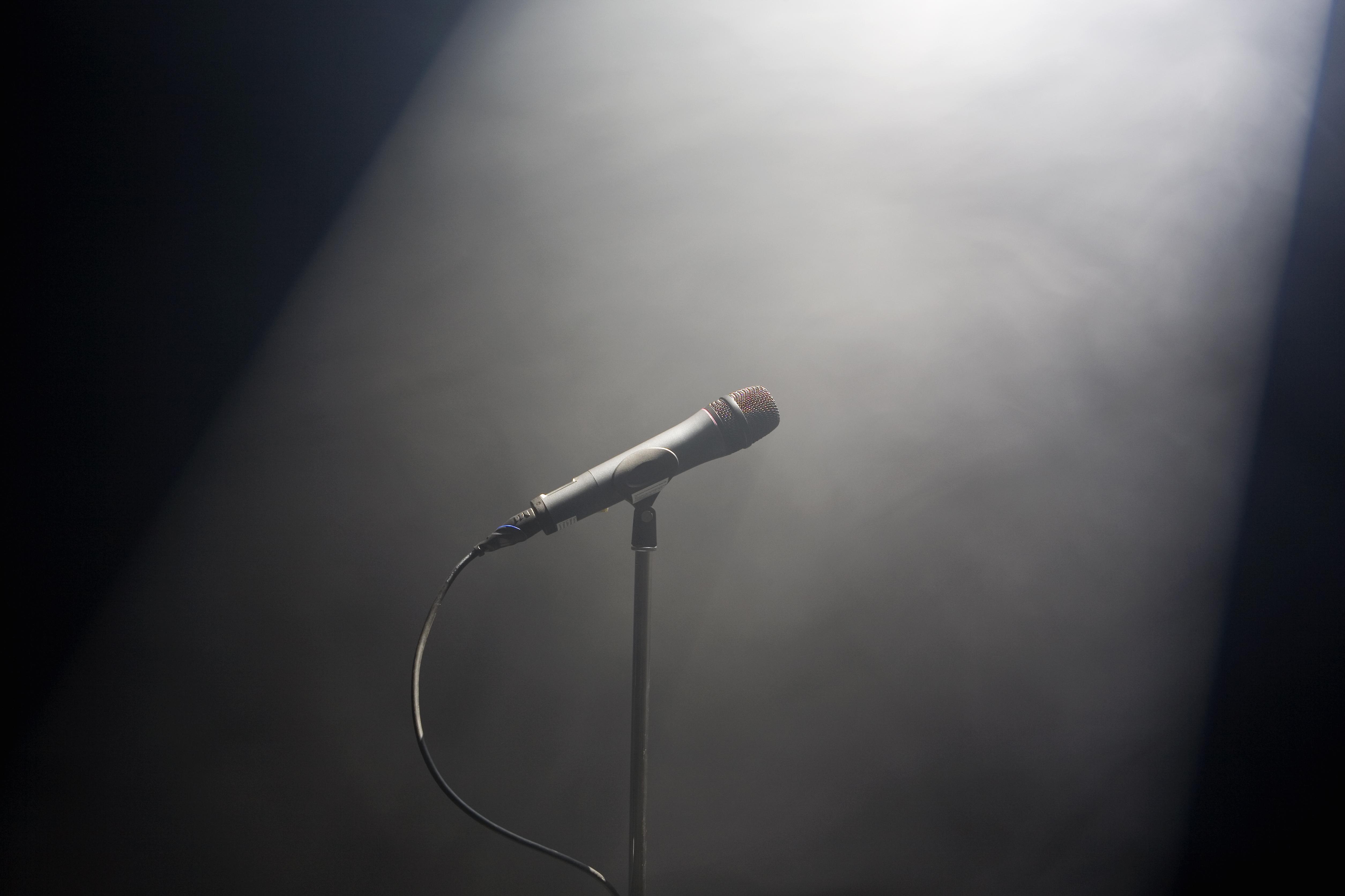 A spot lit microphone stand