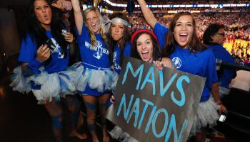 Fans of the Dallas Mavericks cheer befor