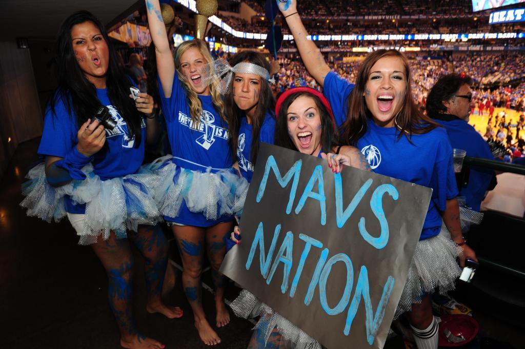 Fans of the Dallas Mavericks cheer befor
