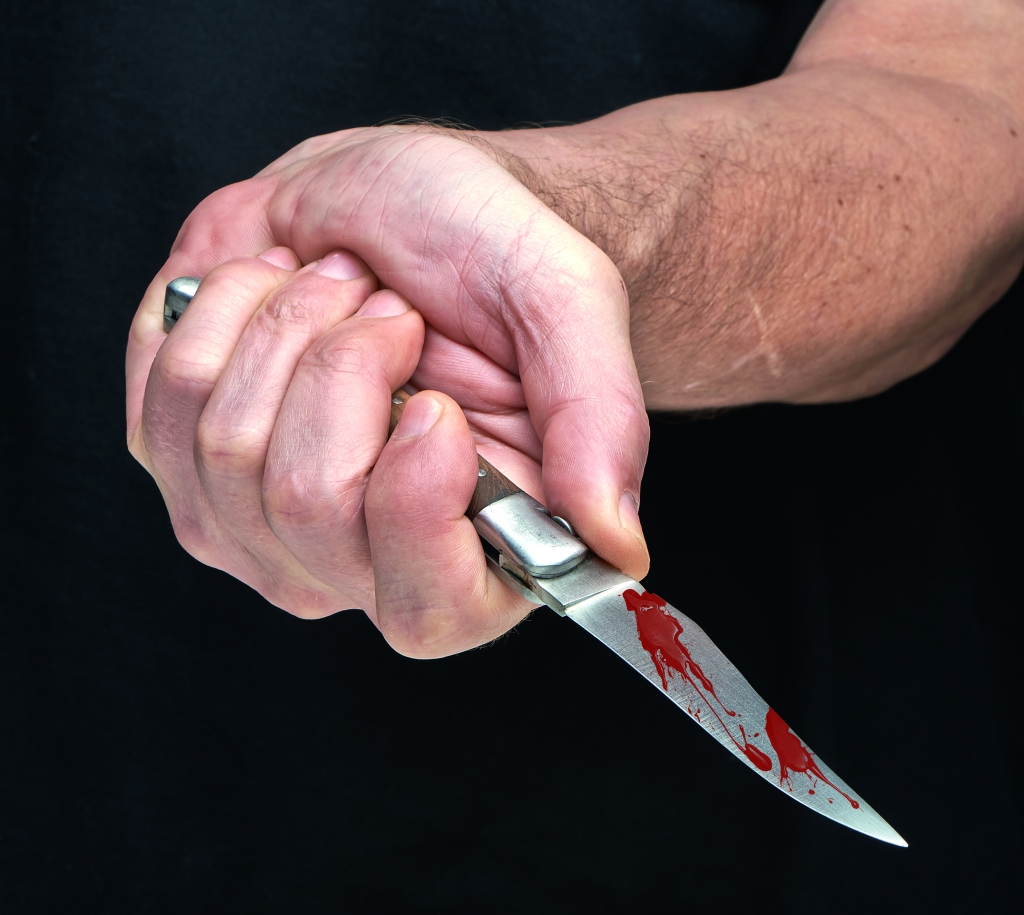 Bloody knife in a hand