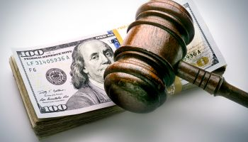 judge's gavel on money