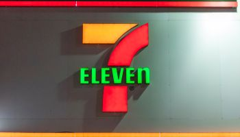 7-Eleven convenience store signage in downtown Toronto. 7-...