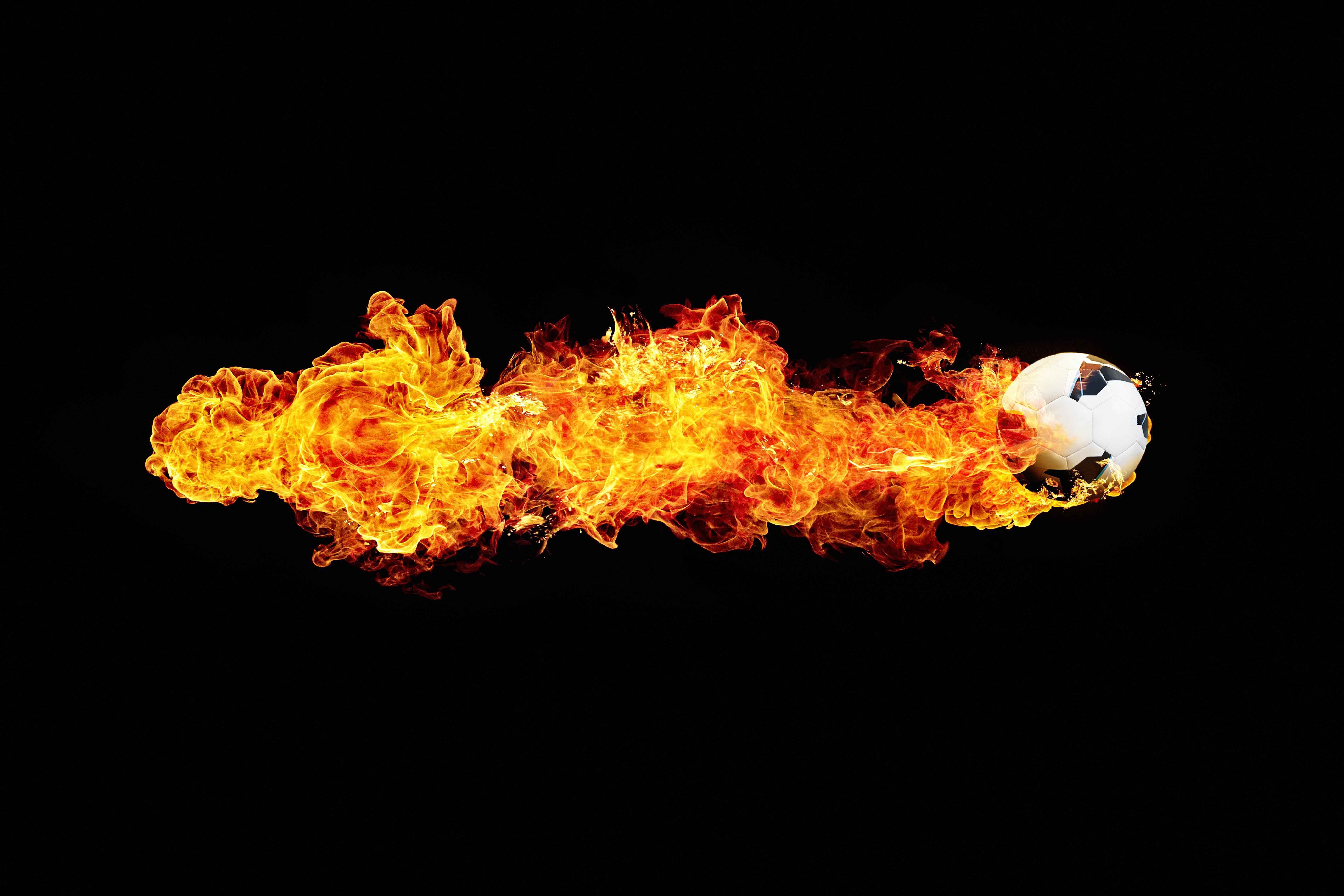 powerful flying football with flame trail