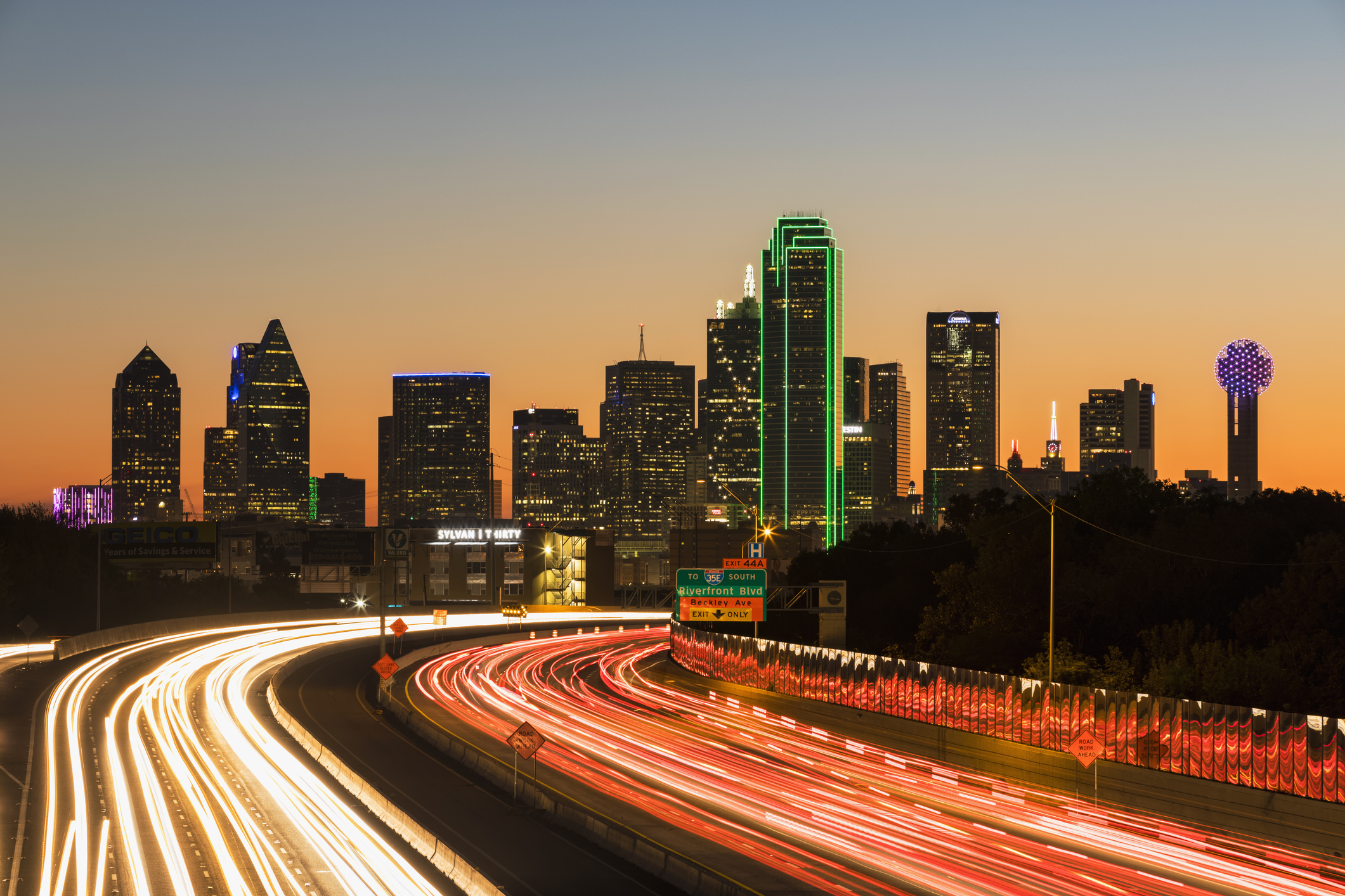 USA, Texas, Dallas, skyline and Tom Landry Freeway, Interstate 30 at night