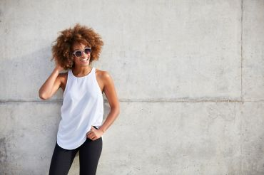 Happy woman wearing tank top and sunglasses