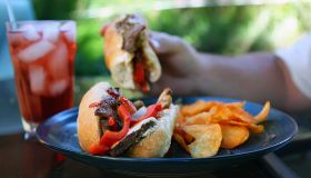 Cheese steak sandwich with red peppers and chips