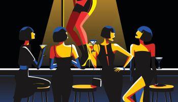 Women watching pole dancer in nightclub bar