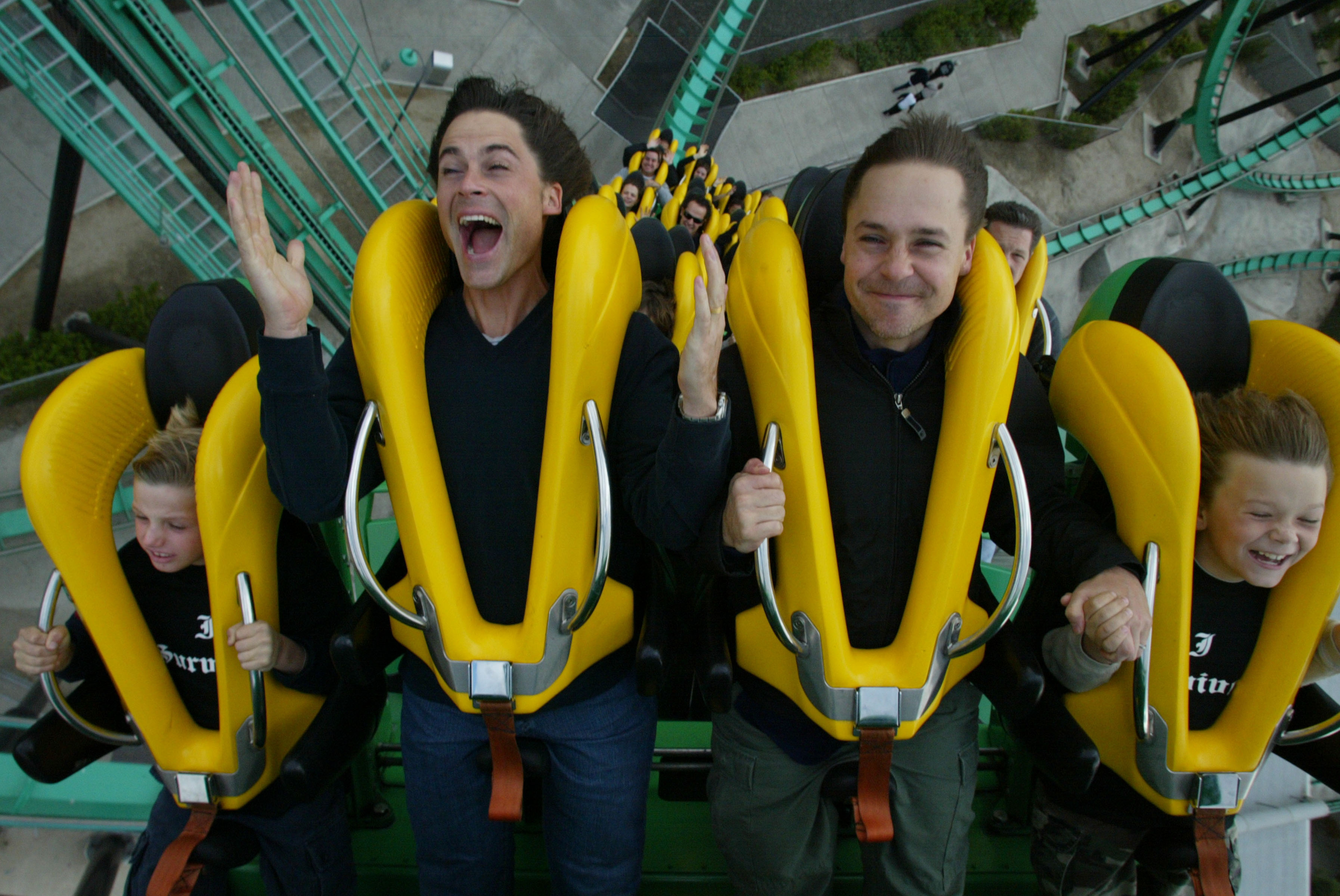 Rob and Chad Lowe ride 'Riddler,' at Six Flags Magic Mountain