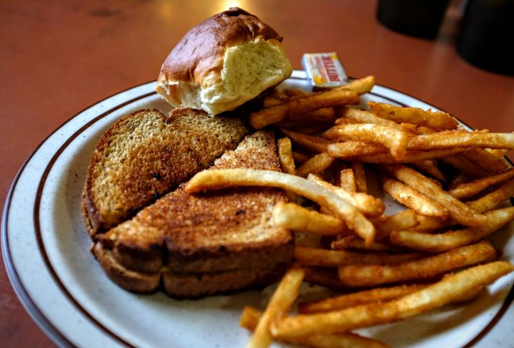 Close-Up Of Grilled Cheese Sandwich With French Fried And Bread Served On Table