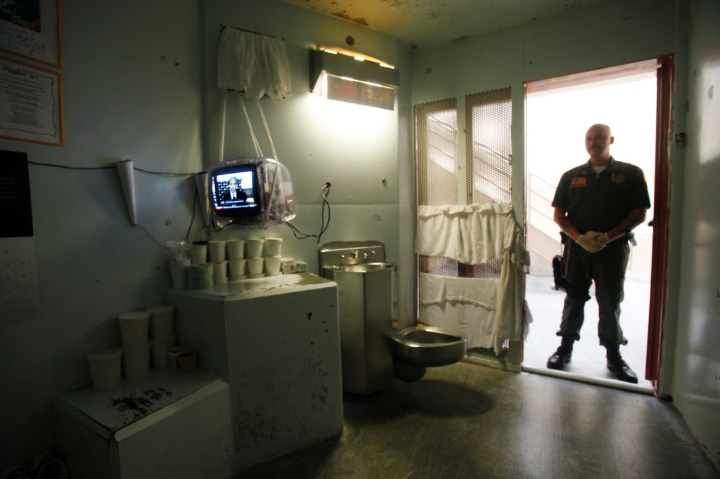 A guard stands in the doorway of one of the Secure Housing Unit (SHU) at Pelican Bay State Prison i