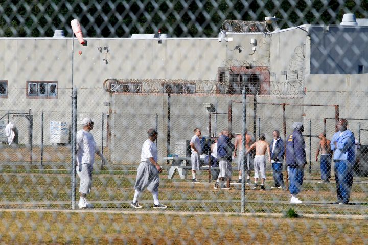 Inmates in Unit B at Pelican Bay State Prison in Crescent City, California exercise and a talk in t