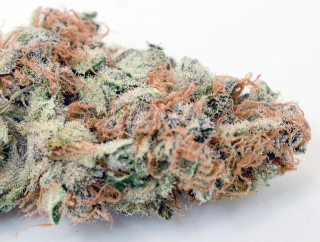 Close-Up Of Dry Marijuana On Table