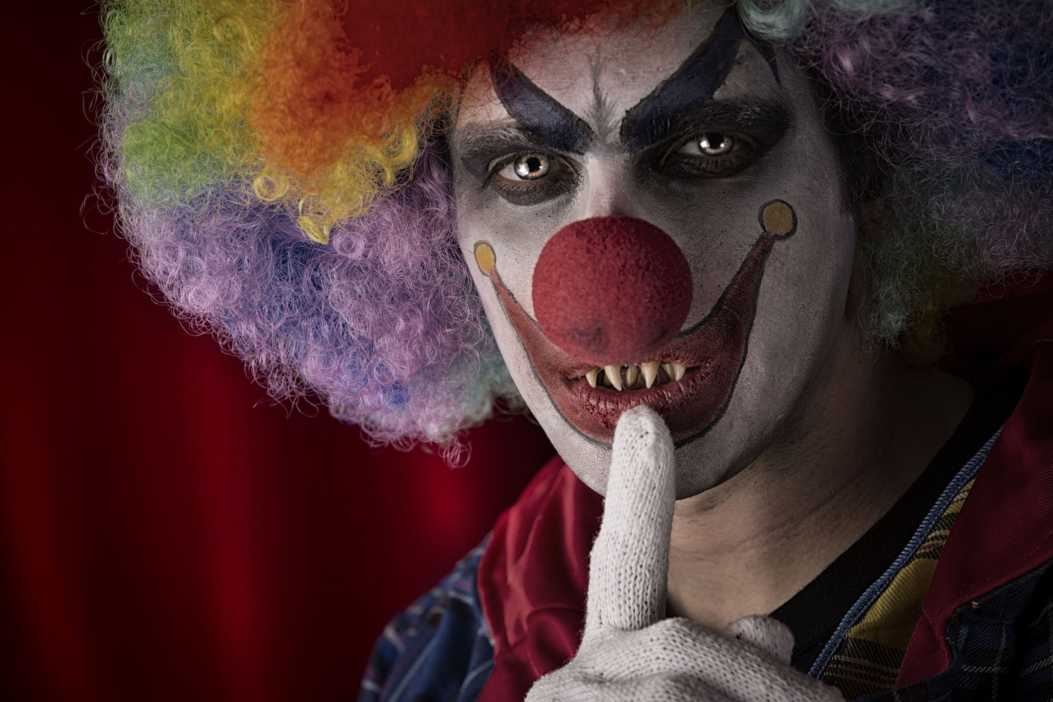 Creepy Clown with fingers on lips