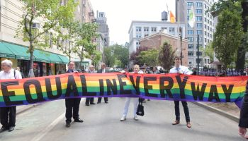 'Equal In Every Way' banner on Christopher Street. Mayor...