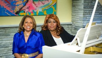 Aretha Franklin and Cathy Hughes