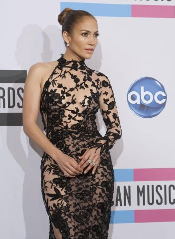 Jennifer Lopez poses after winning Best