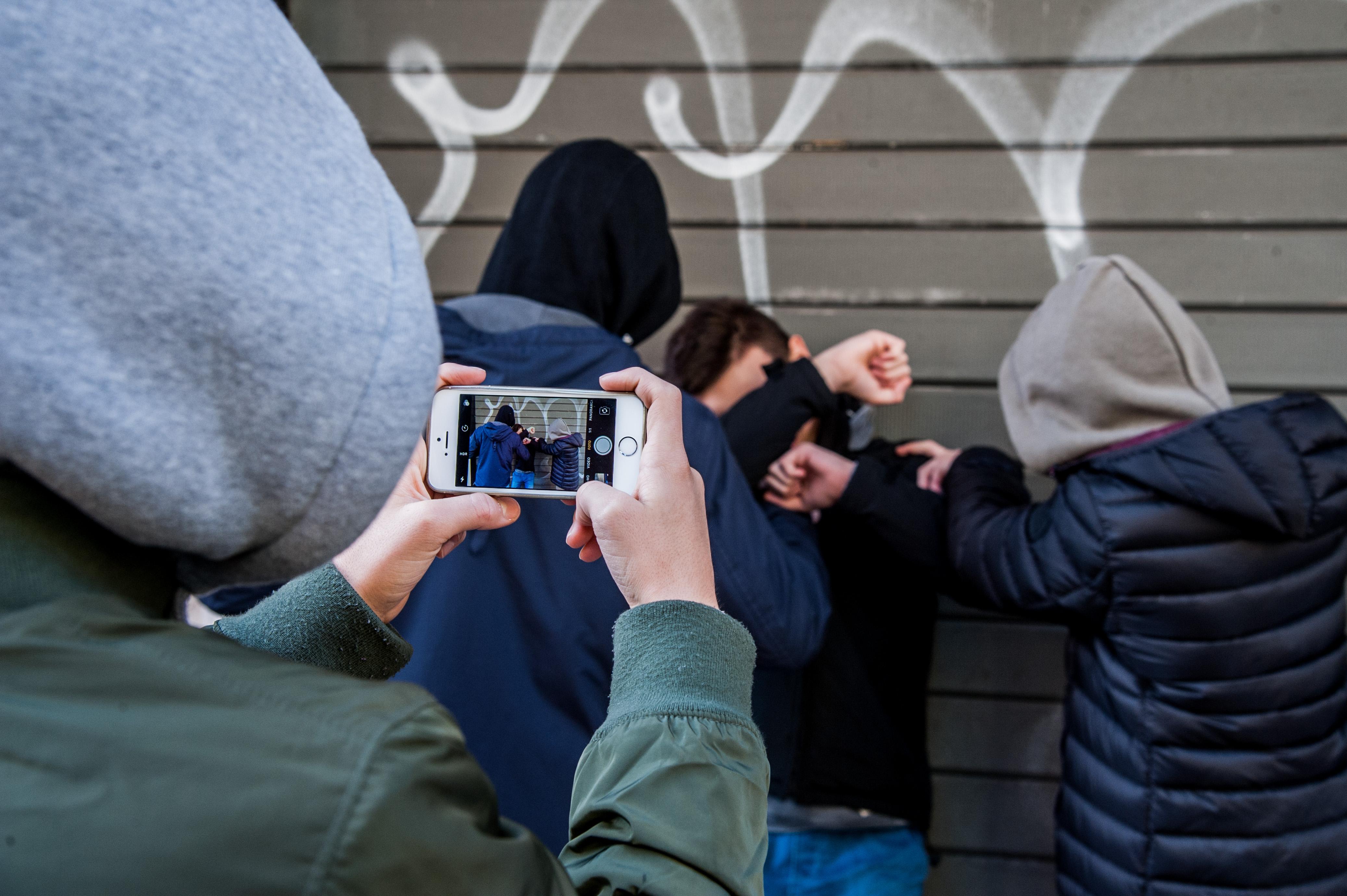 A group of boys bullies a peer in Rome