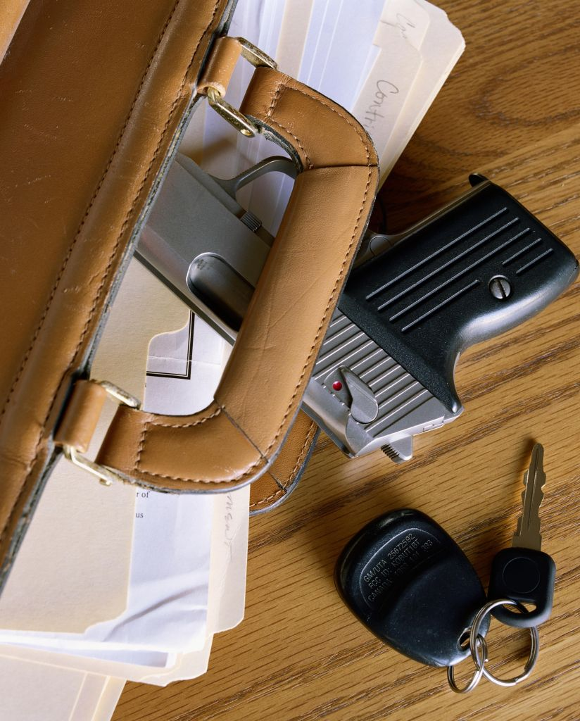Pistol in briefcase, overhead view, close-up