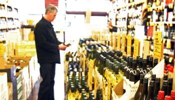 Man chooses wine in liquor store