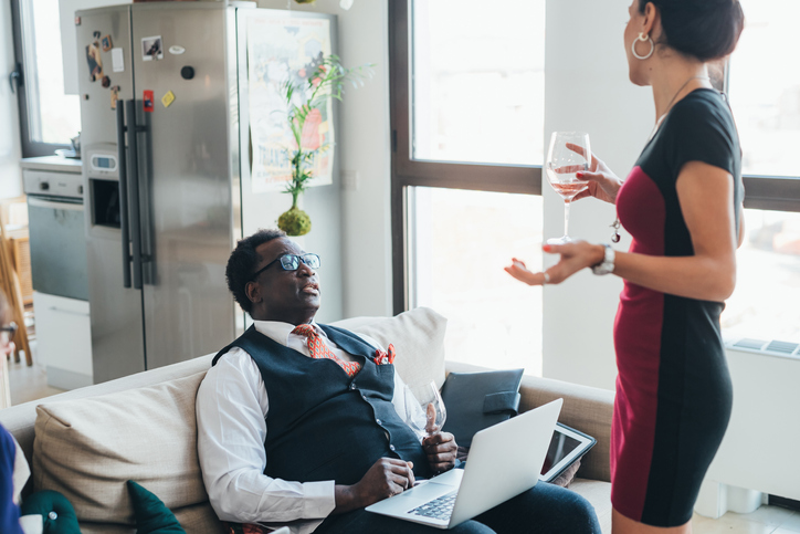 Businessman and businesswoman talking in loft office