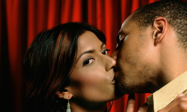 Black Couple Kissing