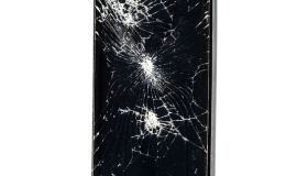 Mobile phone with broken glass on a white background.