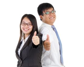 Smiling Business Colleagues Standing Against White Background