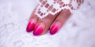 Close-Up Of Woman Fingers With Nail Art Manicure with neon colour