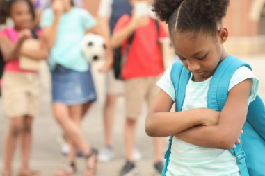 Elementary age, African American girl being bullied at school.