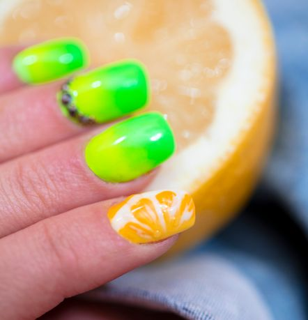Close-Up Of Woman Fingers With Nail Art Manicure with neon green colour