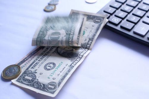 US dollar, coins and calcualtor
