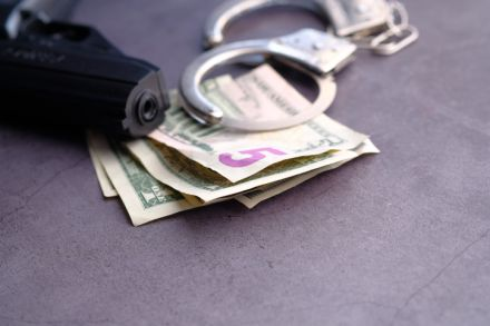 cash and handcuff on table