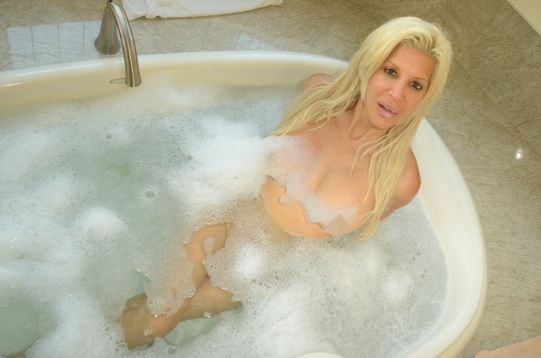 Angelique 'Frenchy' Morgan takes a sexy bubble bath in her new Malibu Vacation home