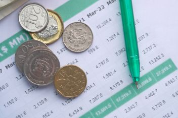 coins , pen and accounting data