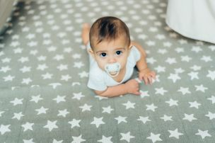 6 month old baby boy posing to camera