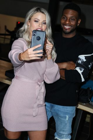 Witney Carson and Kel Mitchell arrive at ABC's 'Dancing With The Stars' Season 28 Top Six Finalists Party held at Dominique Ansel at The Grove on November 4, 2019 in Los Angeles, California, United States.