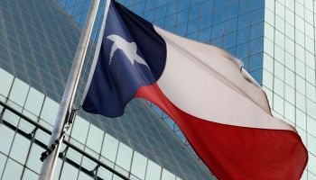 Texas flag against glass office building