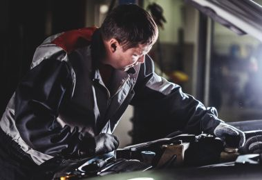 Auto Repair Services. Checking motor oil level